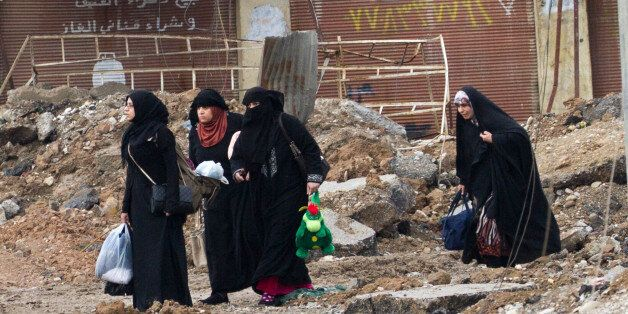 A group of woman fled from the embattled district of Bakr in the south-east of Mosul / Iraq. (Photo by...