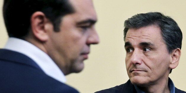 Newly-appointed Finance Minister Euclid Tsakalotos looks on during his swearing in ceremony as Greek...