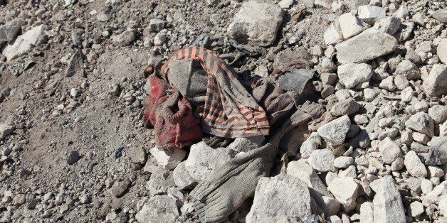 IDLIB, SYRIA - APRIL 05: A shattered outwear of a gas attack victim is seen in the town of Khan Shaykun,...