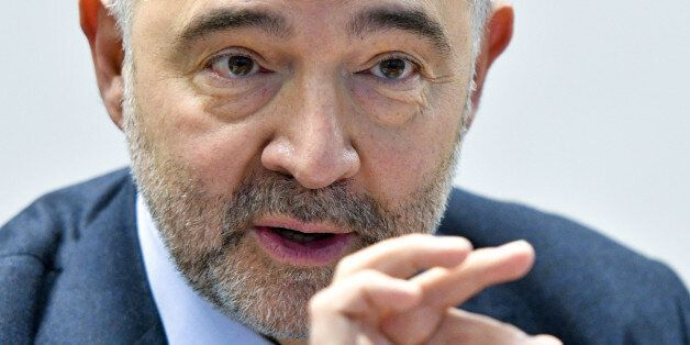 European Commissioner for Economic and Financial Affairs, Pierre Moscovici, reacts during the press meeting...