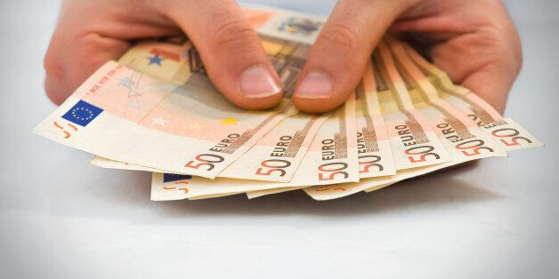 Hands with stack of fifty euro