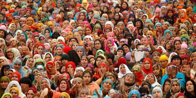 Kashmiri Muslim women watch a relic of Prophet Mohammad being displayed during the festival of Eid-e-Milad...