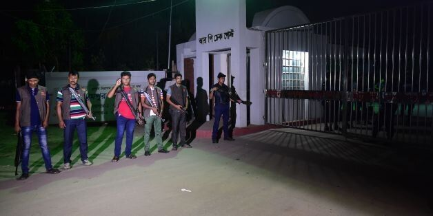 Bangladeshi security personnel stand guard outside the Kashimpur Central Jail on the outskirts of Gazipur...