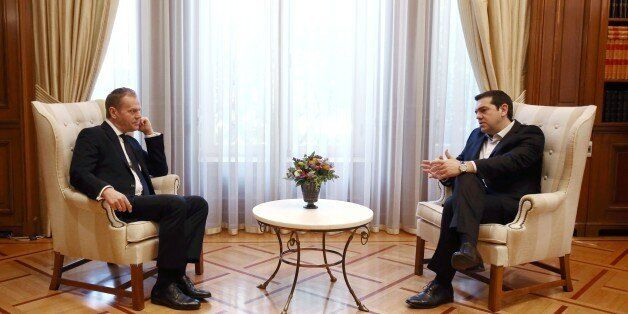 Greek Prime Minister Alexis Tsipas (R) talks with EU President Donald Tusk in his office at Maximos mansion...