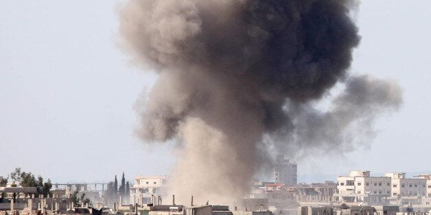 Smoke billows following reported air strikes on a rebel-held area in the southern Syrian city of Daraa,...