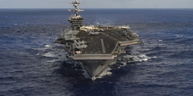 The aircraft carrier USS Carl Vinson (CVN 70) transits the Pacific Ocean January 30, 2017. U.S. Navy...