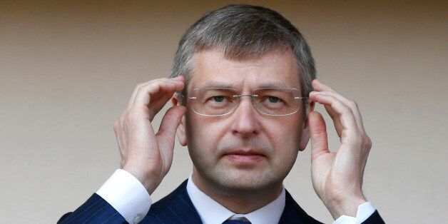 Russian president of AS Monaco football club, Dmitri Rybolovlev gestures at the start of a French L2...