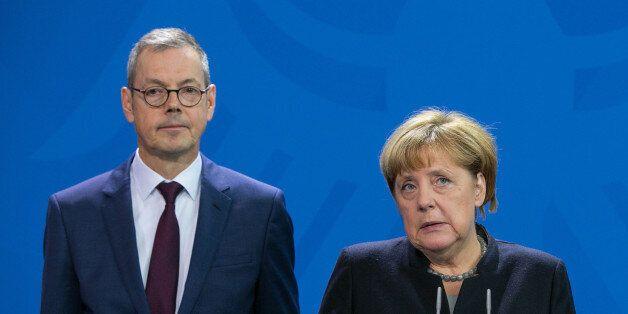 Angela Merkel, Germany's chancellor, center, speaks as Peter Bofinger, economist and member of the German...
