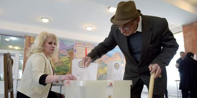 A man casts his ballot at a polling station in Yerevan, on April 2, 2017, as Armenians vote for legislative...