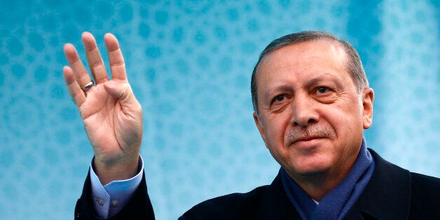 Turkish President Tayyip Erdogan greets his supporters during a rally for the upcoming referendum in...