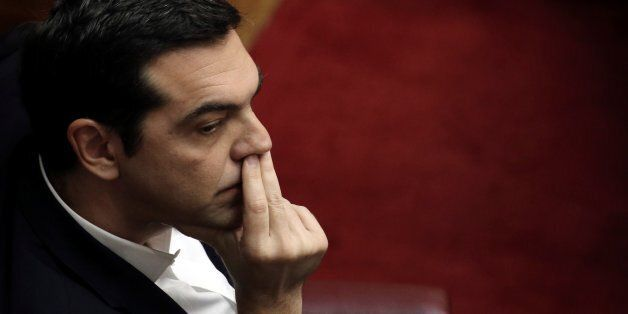 Greek Prime Minister Alexis Tsipras looks on during a session for the Prime Minister's Question Time,...