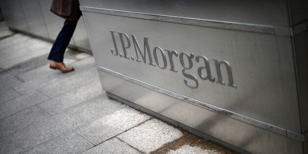 A man walks into the JP Morgan headquarters at Canary Wharf in London May 11, 2012. REUTERS/Dylan Martinez/File...