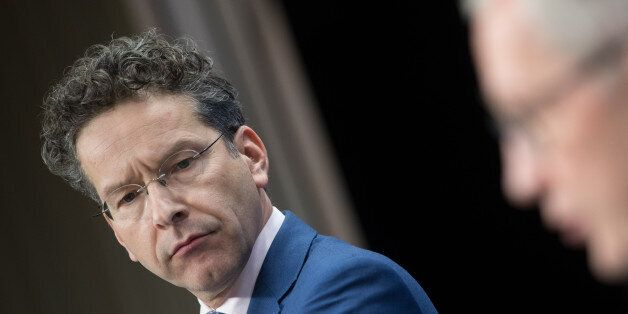 Jeroen Dijsselbloem, Dutch finance minister and head of the group of euro-area finance ministers, listens...