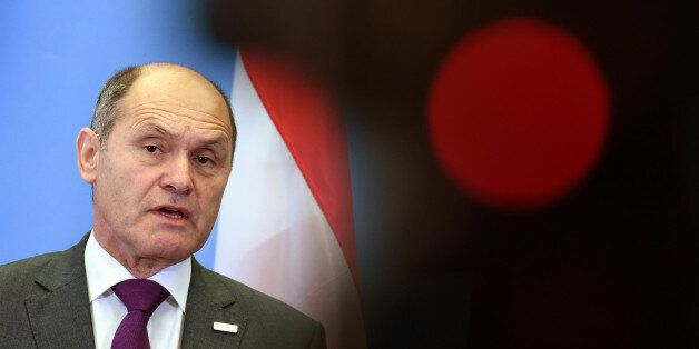 Austrian Interior Minister Wolfgang Sobotka attends a joint press conference with his German counterpart...