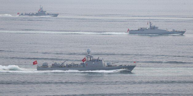 CANAKKALE, TURKEY - MARCH 16: Frigates belonging to the Turkish Navy pass through the Canakkale Strait...