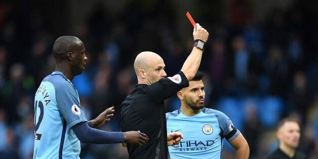 MANCHESTER, ENGLAND - DECEMBER 03: Sergio Aguero (R) of Manchester City is shown a red card by referee...