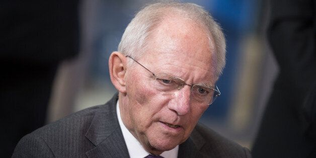 Wolfgang Schaeuble, Germany's finance minister, speaks to reporters as he arrives for a Eurogroup meeting...