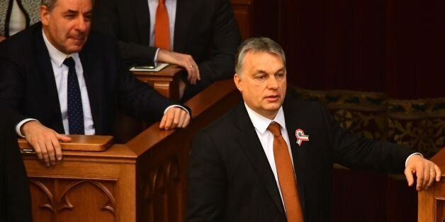 Hungarian Prime Minister Viktor Orban (R) waits for the result of the presidential election at the Hungarian...