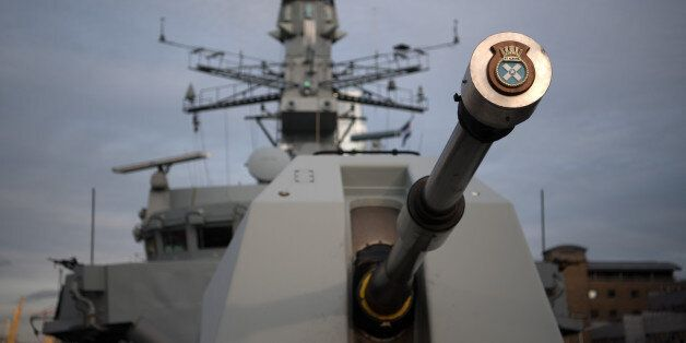 LONDON, ENGLAND - MARCH 07: The gun of HMS St Albans is pictured as the ship is moored in Canary Wharf...