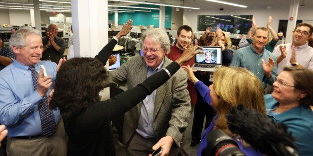 The Miami Herald newsroom reacts to the second of two Pulitzer Prize awards announced on Monday, April...
