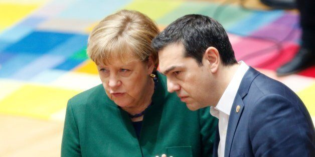 Germany's Chancellor Angela Merkel talks to Greece's Prime Minister Alexis Tsipras during a European...