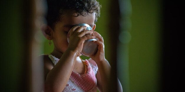 one girl, aged 2, indoor, drinking water,