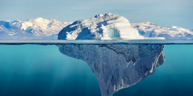 iceberg with above and underwater view taken in