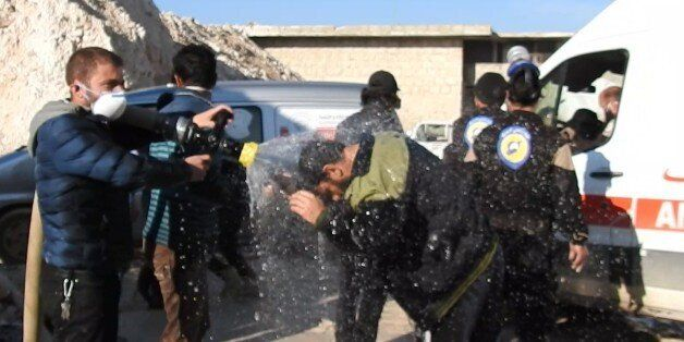 reduce the effectIDLIB, SYRIA - APRIL 4: Civil defense members try to reduce the effects of chlorine...