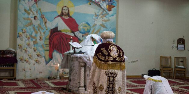 CAIRO, EGYPT - JANUARY 6: Egyptian Coptic Priests lead a prayer during a Christmas Eve mass in a chapel...