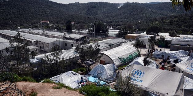 A photo taken on March 16, 2017 shows a view of the Moria migrant camp on the island of Lesbos. The EU-Turkey...