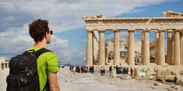 tourist looking at Parthenon, Acropolis ruin, Athens,