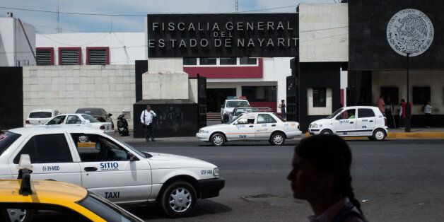 A pedestrian passes in front of the Nayarit State Attorney Generals headquarters in Tepic, Mexico, on...