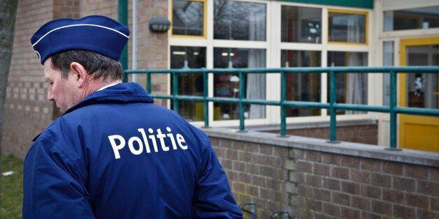 A policeman is seen outside 't Stekske Elementary School in Lommel March 14, 2012. A bus carrying a Belgian...