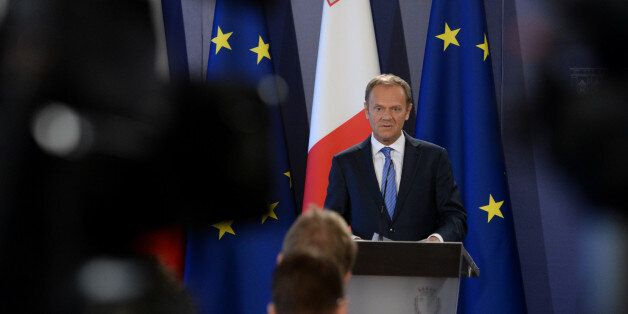 The President of the European Council Donald Tusk (L) speaks during a press conference on March 31, 2017...