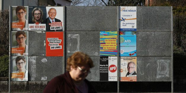 SCHWALBACH, GERMANY - MARCH 15: A woman walks past election campaign posters on March 15, 2017 in Schwalbach,...