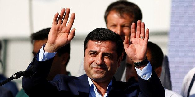 Selahattin Demirtas, co-leader of the pro-Kurdish Peoples' Democratic Party (HDP), greets the crowd during...