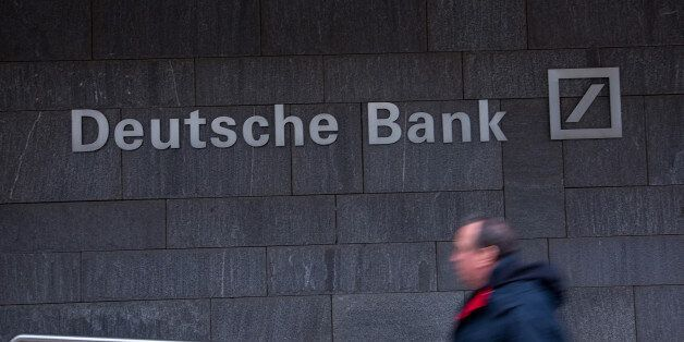 A pedestrian passes a Deutsche Bank AG office in Frankfurt, Germany, on Thursday, Feb. 2, 2017. Frankfurt...