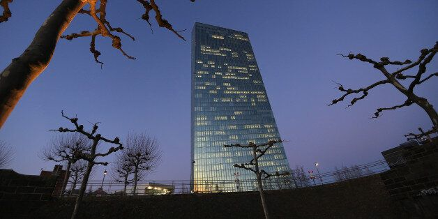 The European Central Bank (ECB) skyscraper headquarters stand illuminated at dusk in Frankfurt, Germany,...