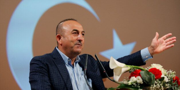 Turkish Foreign Minister Mevlut Cavusoglu addresses supporters during a political rally on Turkey's upcoming...
