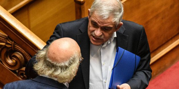 Nikos Toskas, Minister of Citizen Protection attends the Greek Parliament discussion a draft law about...