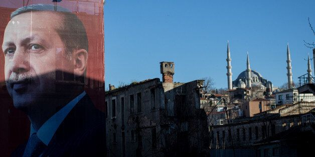 ISTANBUL, TURKEY - MARCH 29: A 'EVET' (Yes) campaign billboard showing the portrait of Turkish President...