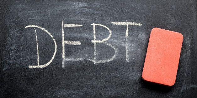 erasing debt, hand written word on blackboard being erased
