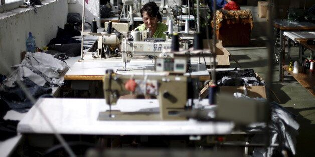 An employee sews while working in a factory in the city of Blagoevgrad, Bulgaria July 2, 2015. Greece...