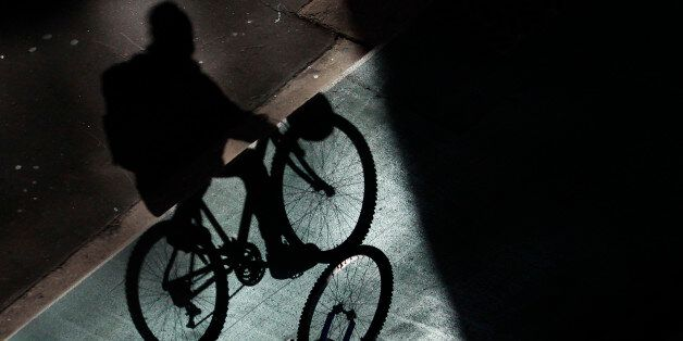 An worker pedals on a bike line in central Sydney August 27, 2012. Australia's top central banker said...