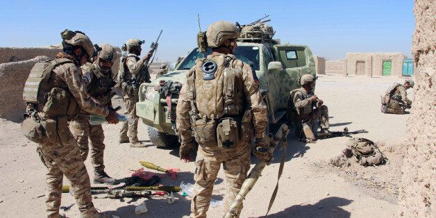 Afghan Special Forces prepare themselves for battle with the Taliban on the outskirts of Lashkar Gah...