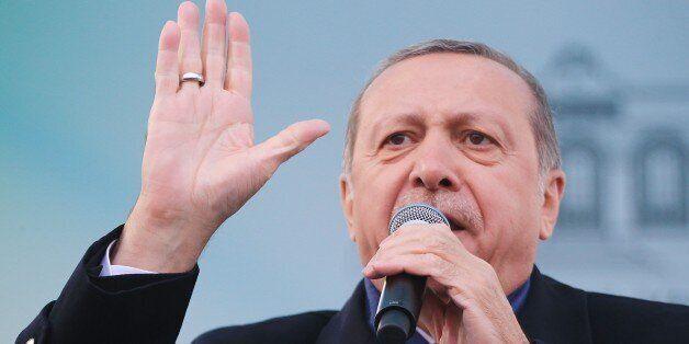 ISTANBUL, TURKEY - MARCH 27: Turkish President Recep Tayyip Erdogan addresses the crowd during a mass...