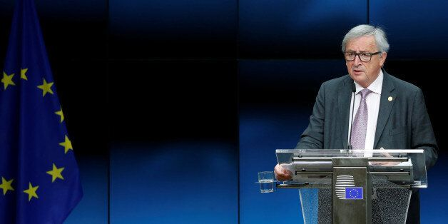 European Commission President Jean-Claude Juncker addresses a news conference during a European Union...