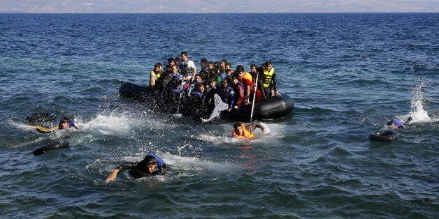 Afghan and Syrian refugees struggle to swim from a dinghy with a broken engine that drifts out of control...