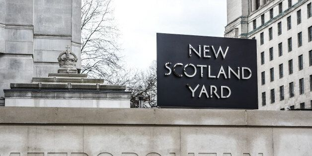 Floral tributes sit outside New Scotland Yard following yesterday's attack in which one police officer...