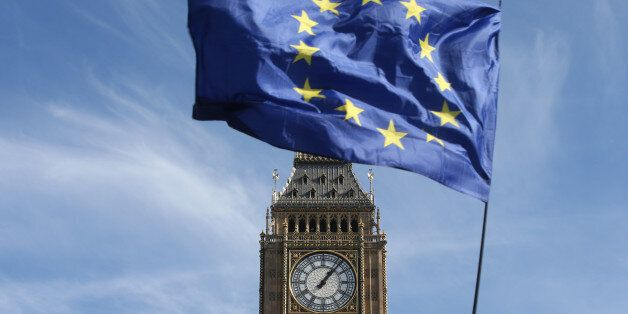 An EU flag flies above Parliament Square during a Unite for Europe march, in central London, Britain...
